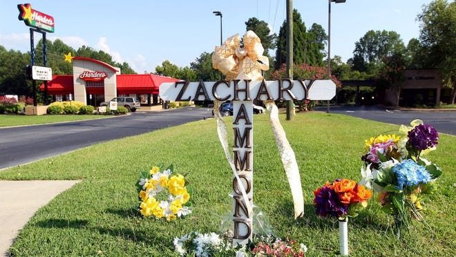 A cross and flowers are placed in front of the Hardee's on U.S. 123 in Seneca where Zachary Hammond was fatally shot by a police officer on July 26, 2015.