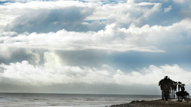 A thick layer of storm clouds approaches Surfers Point in Ventura after a morning of rain in this file photo.