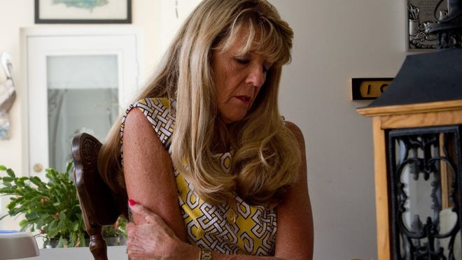 Delta Trudell, widow of David Trudell, is interviewed April 11, 2016 at her home in Port St. Lucie. David Trudell, who was 65, died of Vibrio vulnificus on July 19, 2015, two days after a fish's fin punctured his skin while they were fishing in the Indian River Lagoon.