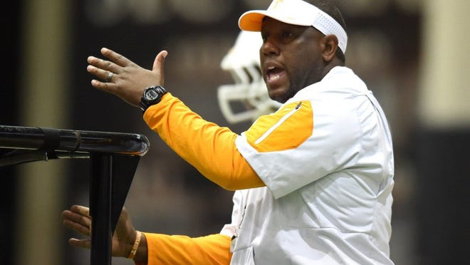 Tennessee's Larry Scott gives instruction while he was tight ends coach during spring practice at the Anderson Training Center on March 24, 2016. He has been promoted to offensive coordinator.