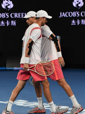 Camarillo's Bob Bryan (back) and Mike Bryan have a quick conversation during their loss to Australia's John Peers and Finland's Henri Kontinen in the men's doubles final at the Australian Open.