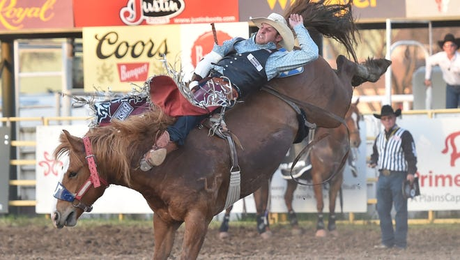 Bareback rider Jessy Davis rides at the first performance of the Red Bluff Round-Up on Friday. The rodeo wraps up with its final performance on Sunday. Nearly 500 cowboys and cowgirls competed in Red Bluff this year.