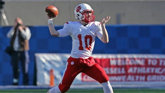 Beechwood quarterback Brayden Burch attempts a pass in the first half.