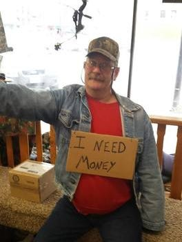 Rick Hill, of Bolivar, wearing a cardboard sign to protest a panhandling ordinance that was repealed Tuesday.