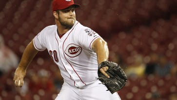 Reds relief pitcher J.J. Hoover delivers a pitch against the Indians on July 17.
