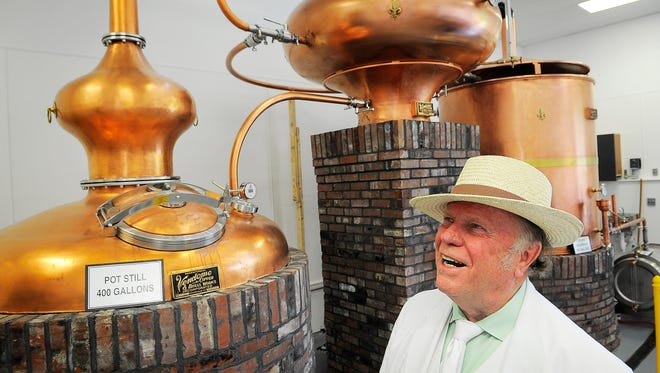 Phil Prichard looks over his alembic still at the grand opening of the Prichard's distillery and the Inn at Fontanel in 2014. The still has been used to make grape brandy, but has been idle for the last year.