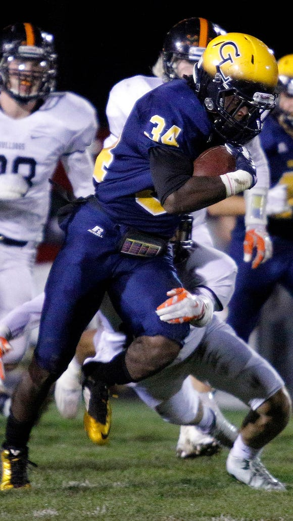 Grand Ledge's Ba Blamo (34) gets away from a Brighton