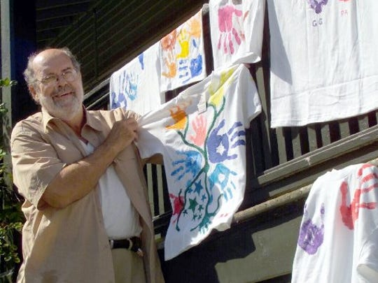 Dave Wortman displays works of art on T-shirts at a 2004 family reunion at Fort Worden.
