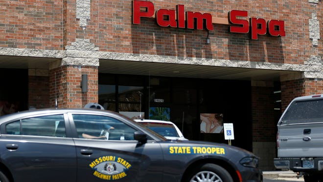 Missouri State Highway Patrol cars sit outside Palm Spa at 2902 S. Campbell Ave. on July 20. Seven months after law enforcement carried out raids in Springfield, no felony charges have been filed.