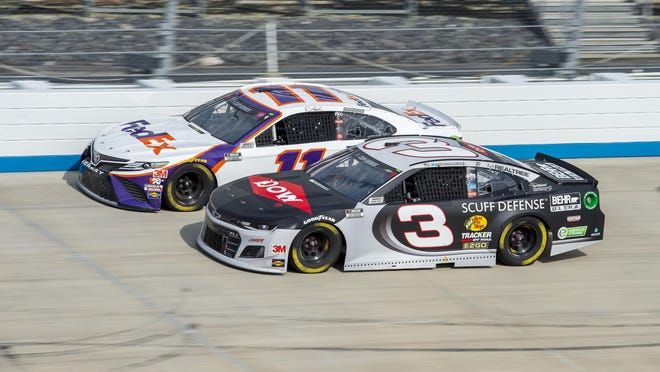 Denny Hamlin (11) passes Austin Dillon (3) for the lead during a NASCAR Cup Series race Saturday at Dover International Speedway in Dover, Del.