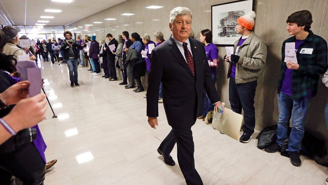 Sen. Randy McNally, R-Oak Ridge, walks past protesters calling for the passage of Gov. Bill Haslam's Medicaid expansion proposal on the opening day of the second session of the 109th General Assembly Tuesday, Jan. 12, 2016, in Nashville, Tenn. (AP Photo/Mark Humphrey)