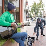 Pensacola rallies around street musician who lost all in fire