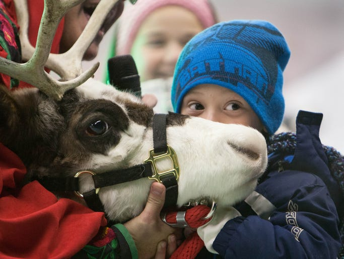 Austin Helm, 6, kisses a reindeer at the annual Westfield in Lights! celebration in downtown Westfield, Dec. 6, 2013. Austin is the son of Alexa and Jeff Helm, Westfield.