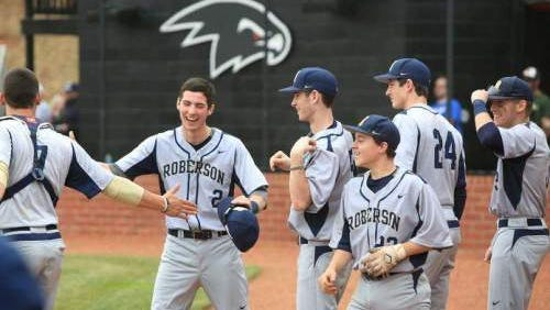 Roberson's baseball team celebrates after a big play Saturday in Weaverville.