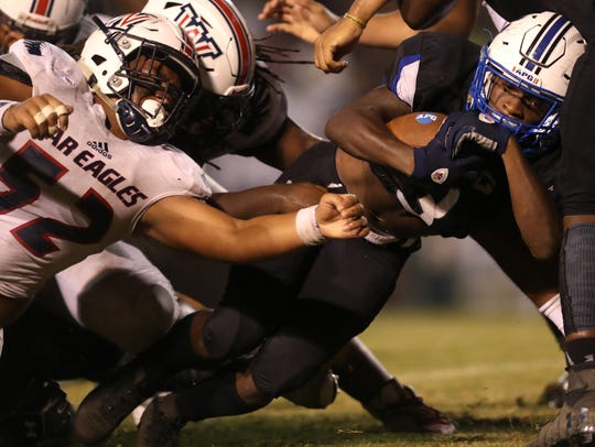 Godby's Jerry Ray pushes for extra yards past Wakulla's