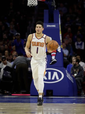 Phoenix Suns' Devin Booker in action during an NBA basketball game against the Philadelphia 76ers, Monday, Dec. 4, 2017, in Philadelphia.