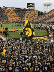 The Hawkeyes take the field against Michigan State on Saturday, Oct. 5, 2013, at Kinnick Stadium in Iowa City. (Bryon Houlgrave/The Des Moines Register)