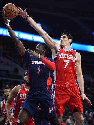 Dec 11, 2016; Auburn Hills, MI, USA; Pistons guard Reggie Jackson attempts a shot as 76ers forward Ersan Ilyasova defends during the first quarter at the Palace. Philadelphia won, 97-79.
