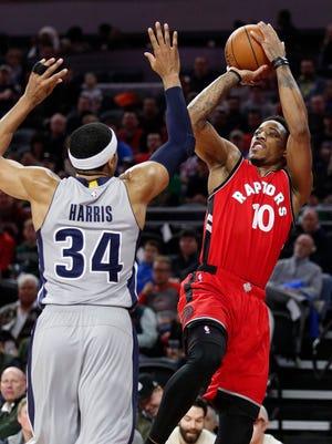 Mar 17, 2017; Auburn Hills, MI, USA; Raptors guard DeMar DeRozan takes a shot over Pistons forward Tobias Harris during the first quarter at the Palace.