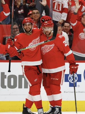 Teams are interested in trading for Red Wings defenseman Mike Green, right, because of his offensive prowess.