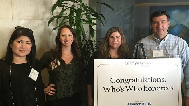 Sentinel Technologies employees celebrate one of their own being honored with the Arizona Republic's Who's Who in Business Highest Ranking Women for the Manufacturing & Technology IT Supplier category.