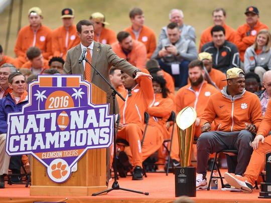 Clemson head coach Dabo Swinney speaks during Clemson's National Championship celebration in Memorial Stadium on Saturday.
