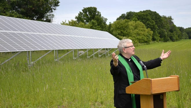 Bishop David Ricken of the Catholic Diocese of Green Bay gives a prayer of blessing at the dedication of the year-old solar-powered energy system June 18 on the convent grounds of Sisters of St. Francis of the Holy Cross in Green Bay.