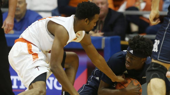 UTEP's Earvin Morris reaches to steal the ball from Rice's Marquez Letcher-Ellis during the first half Friday.