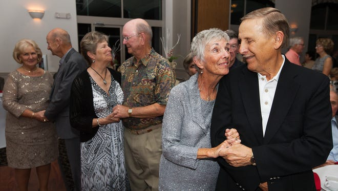 """""""I love the way he cares for me,"""" said Mona Lee Davis, second from right, of her husband Dick, while renewing their wedding vows Sunday at Herons Glen in North Fort Myers. More than 100 couples, married for 50 years, took part in the event."""