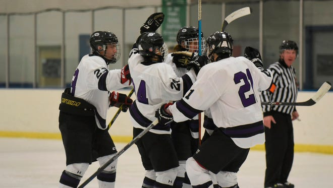 Defenseman Zack Orlandoni (center) is congratulated by his Bloomfield Hills teammates after scoring a first-period goal.