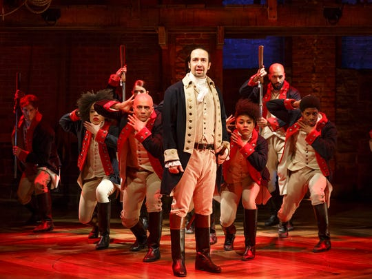 """Lin-Manuel Miranda, foreground, with the cast during a performance of """"Hamilton,"""" in New York."""