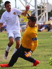 Alamogordo's Julian Torres scores a goal on Lovington's Luis Aceves during the fourth minute Thursday evening.