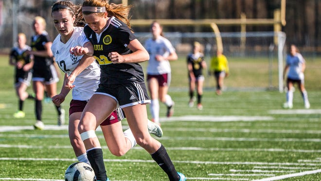 Padua's Mackenzie Scully (No. 22) runs down the sideline with Appoquinimink's Rachel Cressler (No. 12) in the second half of Padua's 4-0 win over Appoquinimink at Appoquinimink High School on Wednesday afternoon.