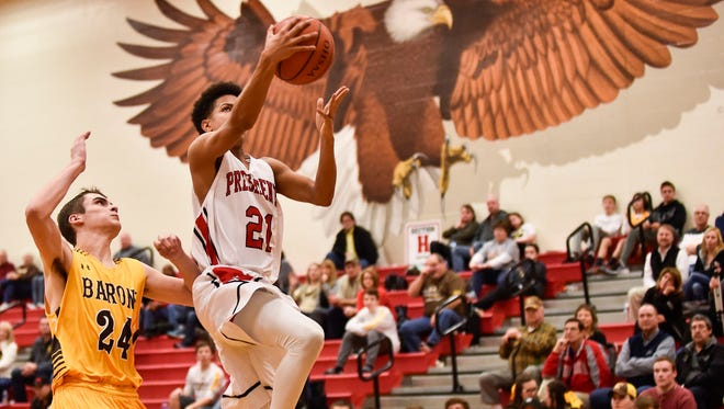 Nate Riddle of Harding finishes a fastbreak in a game against Buckeye Valley where the Presidents earned their first-ever Mid Ohio Athletic Conference Red Division title in boys basketball.