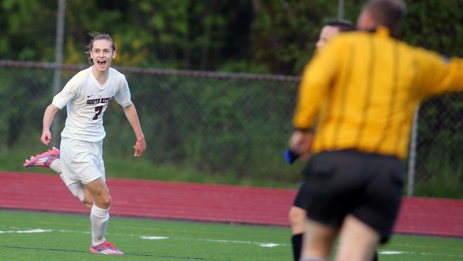 South Kitsap soccer player Grant Larson has a big smile after he scored a goal against Curtis at South on Thursday.
