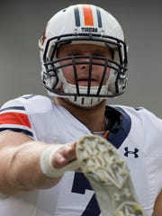 Auburn offensive lineman Braden Smith (71) stretches