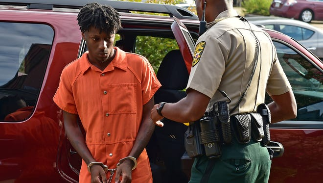 Vicksburg resident Ricky Perkins is escorted into Warren County Circuit Court by a sheriff's deputy Tuesday morning. Perkins is charged with second degree murder, drive-by shooting and three counts of aggravated assault in a shooting early Sunday morning that left one man dead and hospitalized three others.