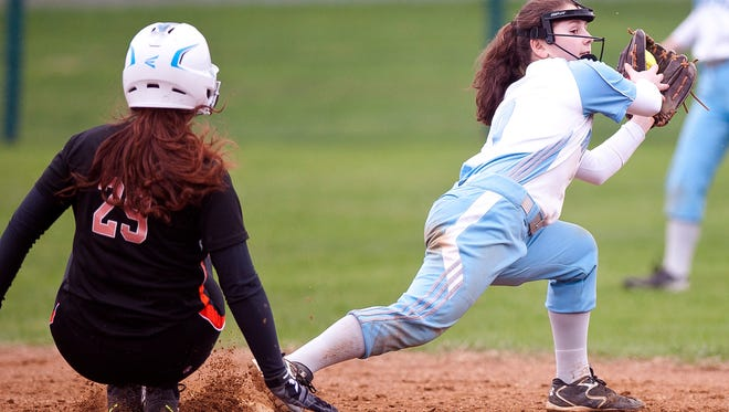 South Burlington shortstop Anna Borrazzo, right, forces out Middlebury's Ashley Sunderland at second base during Tuesday's high school softball game in South Burlington.