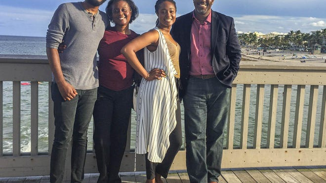 Palm Beach Post reporter Wayne Washington, his wife Shelia, and their son Wayne II and daughter Ashley.