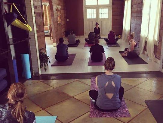 Garden District Yoga will celebrate Vino and Vinyasa