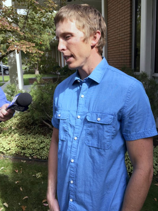 Stephen Vouch of Boise, talks to a reporter on Wednesday, Oct. 7, 2015 at the Idaho Department of Fish and Game in Boise, Idaho and describes being bitten in the back of the head by a black bear while he slept at a hunting camp in central Idaho on Oct. 2. The attack left Vouch, 29, with cuts to the back of his head but he didn't need stitches. A hunting companion shot and wounded the bear that Vouch then shot and killed. State officials estimated the black bear was 3 to 7 years old and weighed from 200 to 275 pounds. (AP Photo/Keith Ridler)