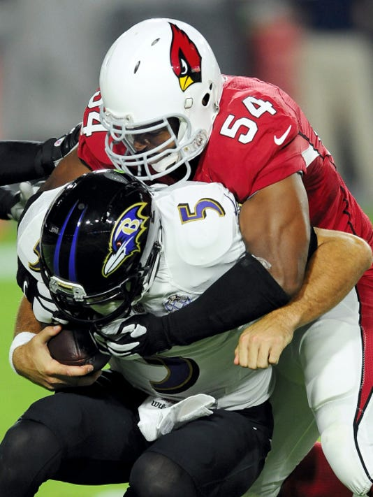 Baltimore quarterback Joe Flacco is tackled by Arizona linebacker Dwight Freeney during a recent game. Flacco and the Ravens have stumbled to a 2-6 start.
