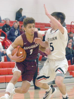 Annawan's Julian Samuels (1) is guarded by Monmmouth United's Drew Brown (5) on Friday.