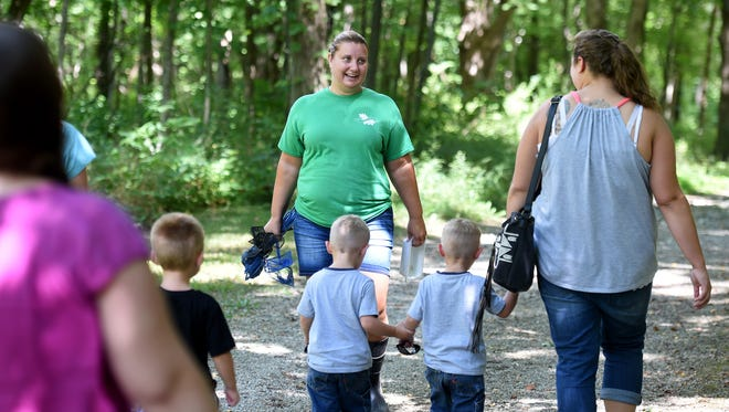 Naturalist Stephanie McCurdy leads participants of the Birth-to-Five Book Buddies program on an August hike at Hayes Arboretum in Richmond. The Stamm Koechlein Family Foundation, which recently has funded the arboretum's naturalist position, received a new honor from the arboretum for its longtime support.