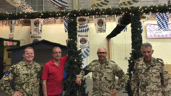 From left, Master Sgt. Markus Weber, Franz Huber, 1st Lt. Marco Hauff and Command Sgt. Maj. Juergen Klinger are helping to organize the annual German Christmas Bazaar.
