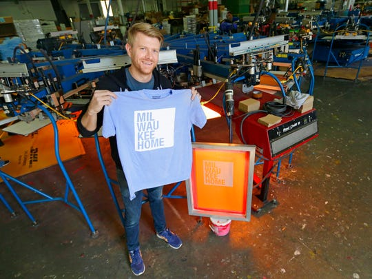 Redwall Screen Printing owner Jeff Meilander holds