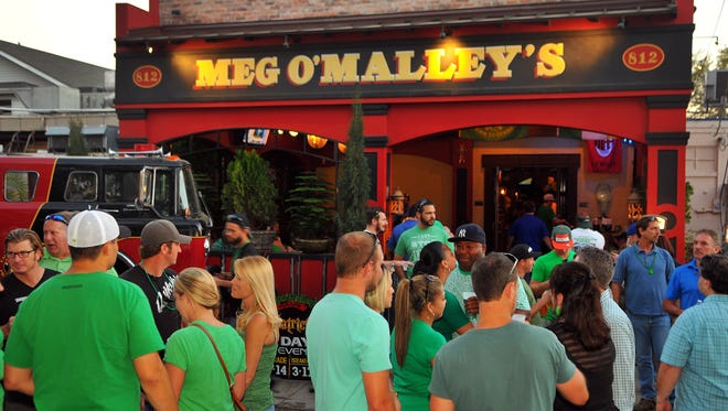 Crowds gathered during the Meg O'Malley's St. Patrick's Day street party last year in downtown Melbourne.