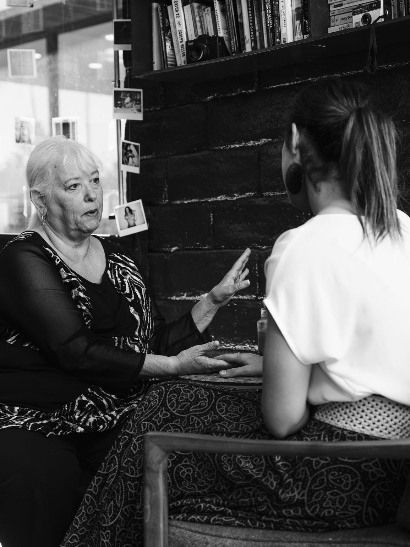 Kae Schreiber facilitates a palm reading in Gré Coffeehouse