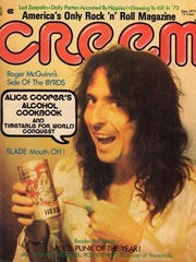 Alice Cooper shows off a can of Boy Howdy! Beer on