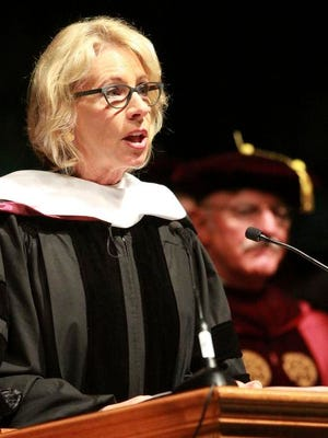 "U.S. Secretary of Education Betsy DeVos delivers the commencement address to Bethune-Cookman University graduates at the Ocean Center in Daytona Beach, Fla., Wednesday, May 10, 2017. Drawing shouts of ""Liar!"" and ""Just go,"" DeVos powered through her commencement address Wednesday at the historically black university, even as many of the graduating students turned their backs to her in protest. (David Tucker/The Daytona Beach News-Journal via AP)"